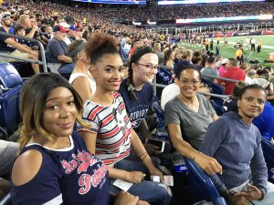 FOCUS@114 residents and staff at a Patriots game.